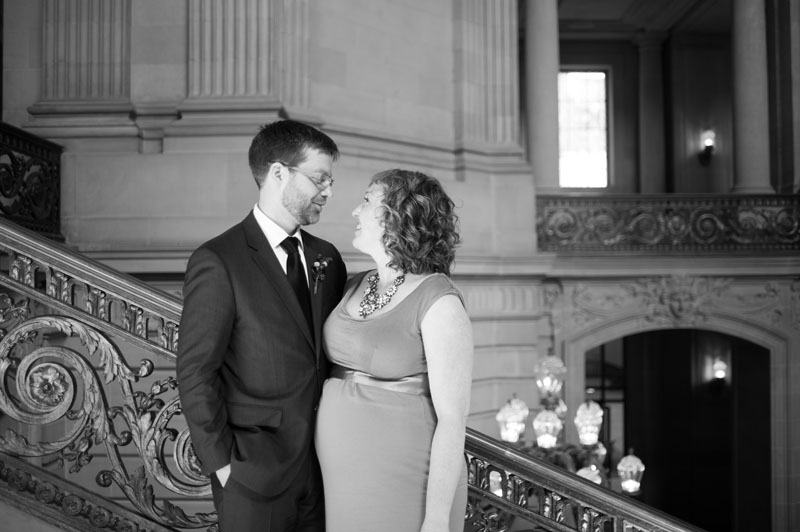 Portrait of Bride and Groom on staircase in San Francisco City Hall