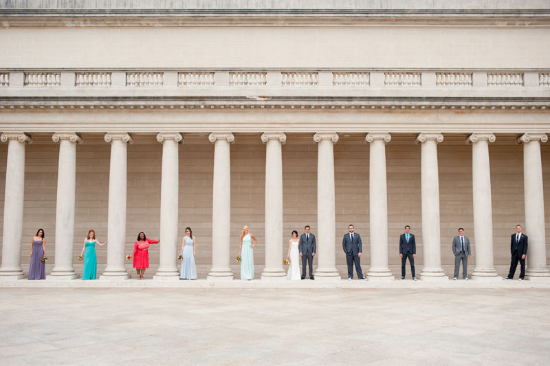 Wedding party in between columns at The Legion of Honor