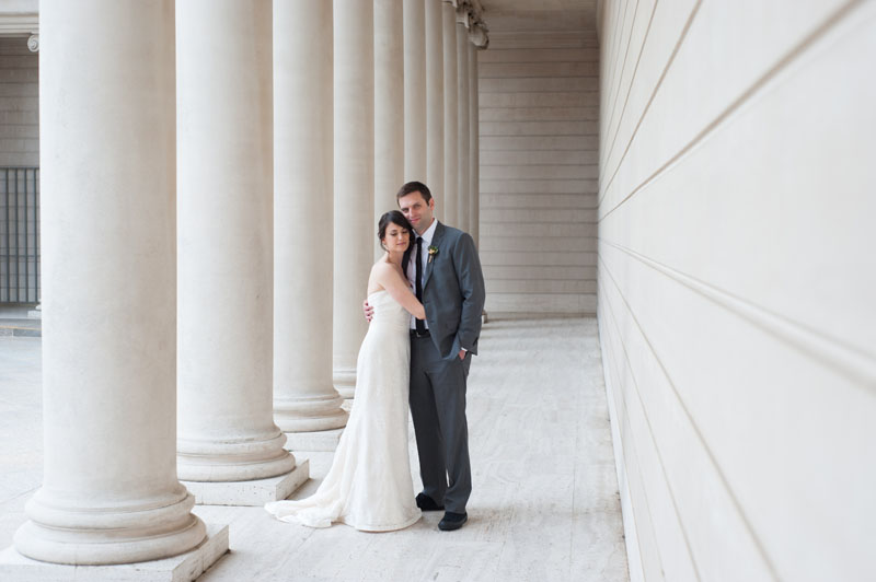 Bride and Groom with columns at The Legion of Honor in San Francisco
