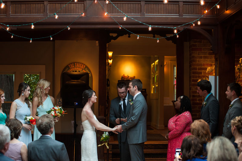 Bride and Groom holding hands during ceremony at the Tavern at Lark Creek