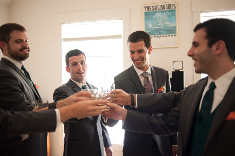 Groom and his groomsmen doing shots before ceremony