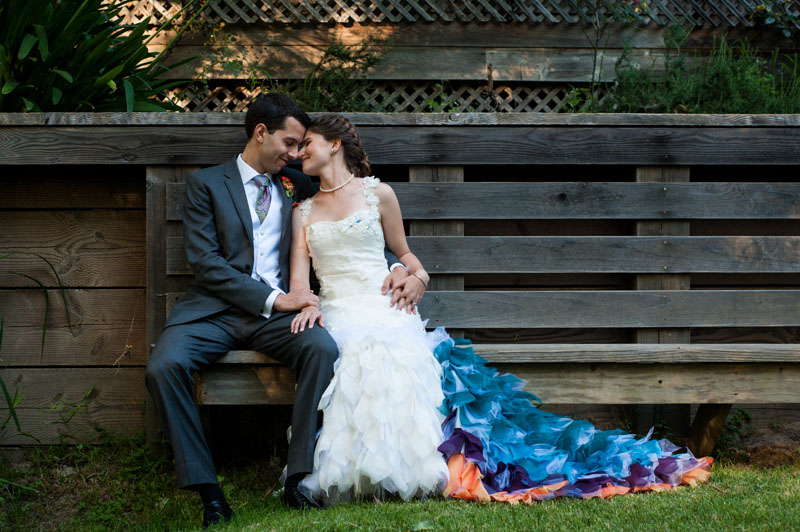 Bride and Groom share a moment on a wooden bench in Point Reyes