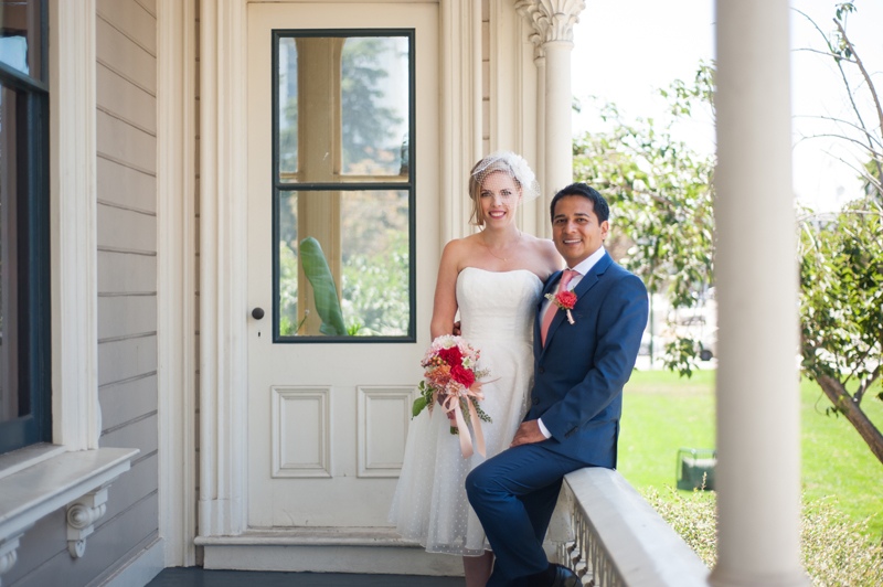 Bride and Groom on the porch of the Camron-Stanford house in Oakland