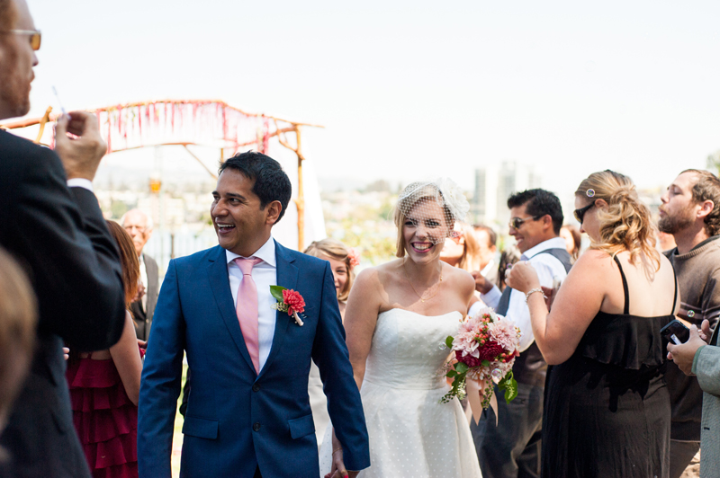 Bride and Groom walk down the aisle after ceremony at Camron-Stanford House