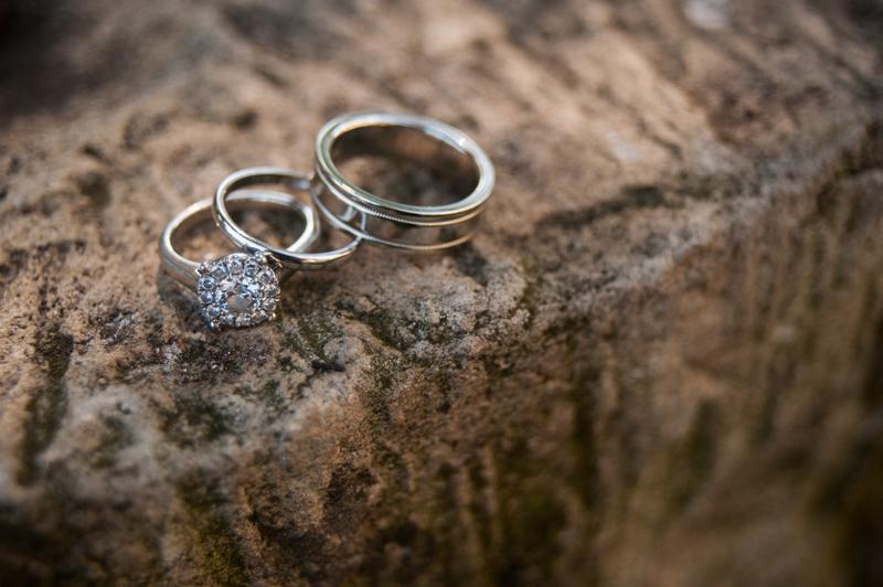 Detail of wedding rings on stone
