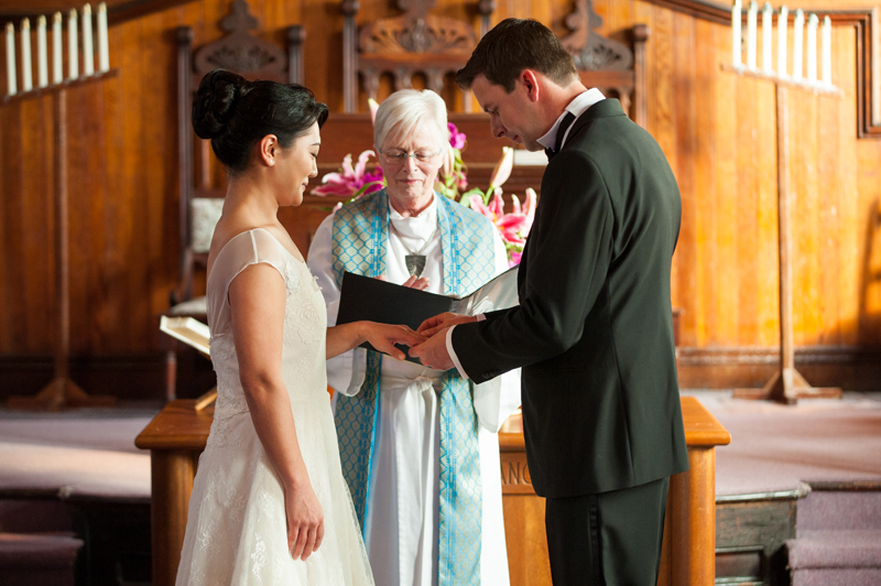 Couple exchanging rings in Calvary Presbyterian Chapel in Bolinas