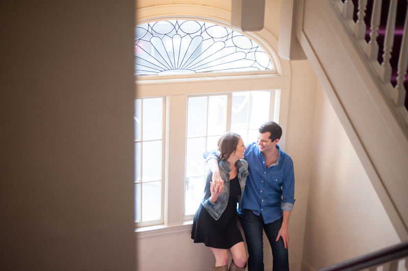 Couple hanging out in apartment engagement session