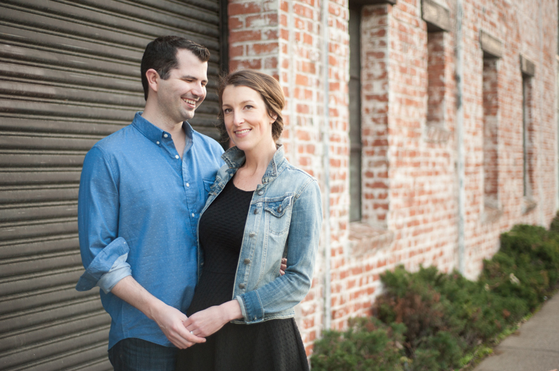 Couple in front of brick building