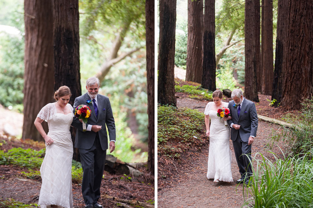 Bride walking beneath redwoods with father