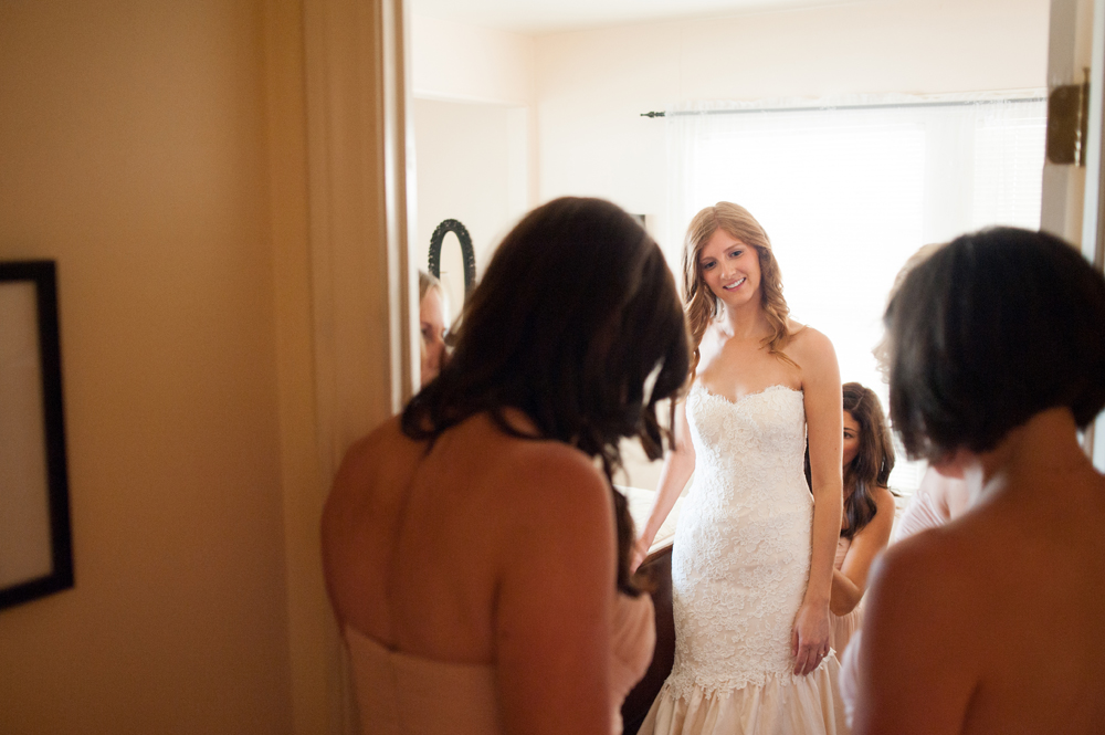 Bride being helped into wedding dress at the Vine Hill House