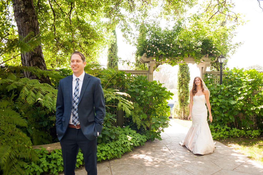 Bride and groom during first look at the Vine Hill House