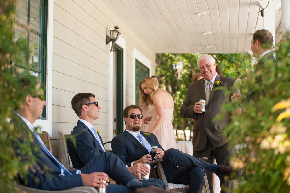 Groomsmen relaxing on the Vine Hill House porch