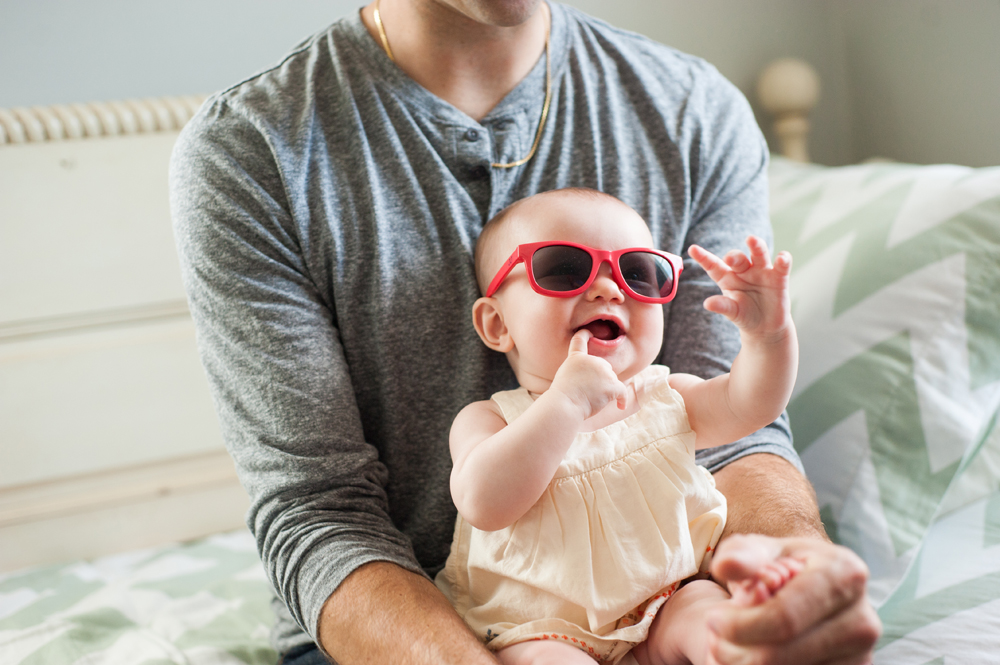 Funny candid of baby wearing sunglasses