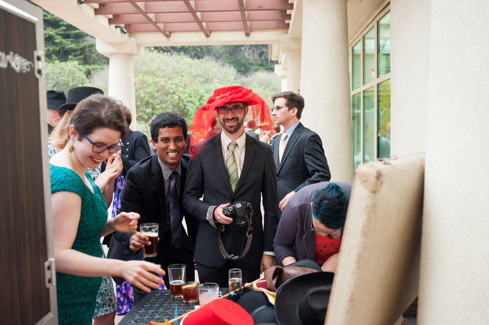 Wedding guests having fun with photo booth props