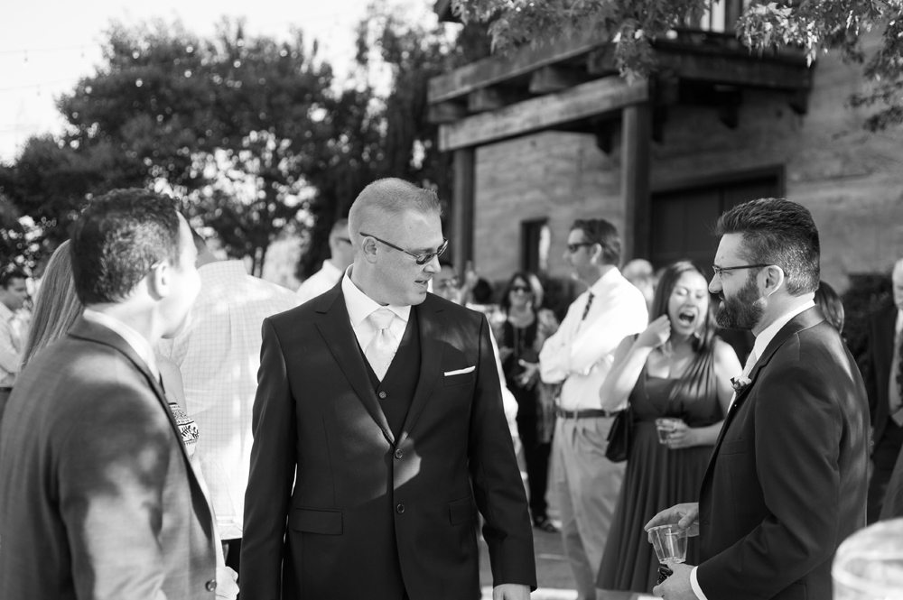 Groom greeting wedding guests at Murrieta's Well