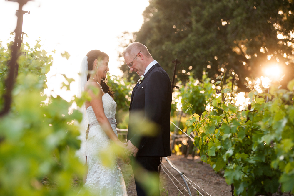 Candid of bride and groom in vineyards at Murrieta's Well in Livermore