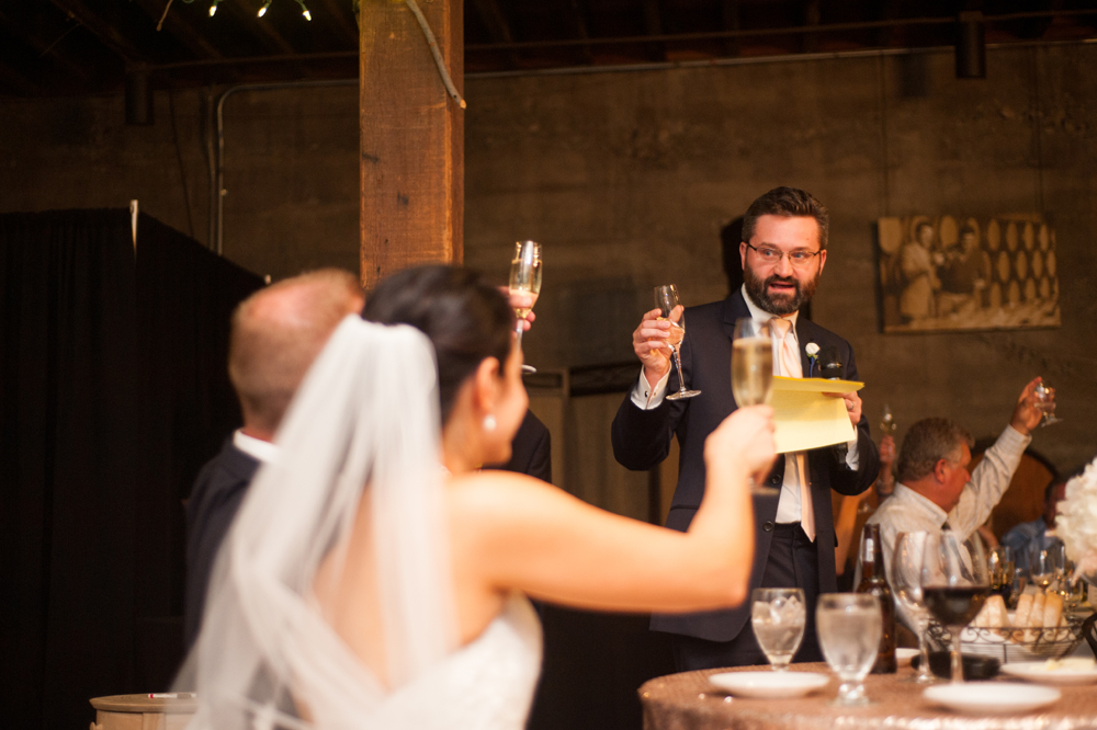 Bride and groom raising a glass during toasts