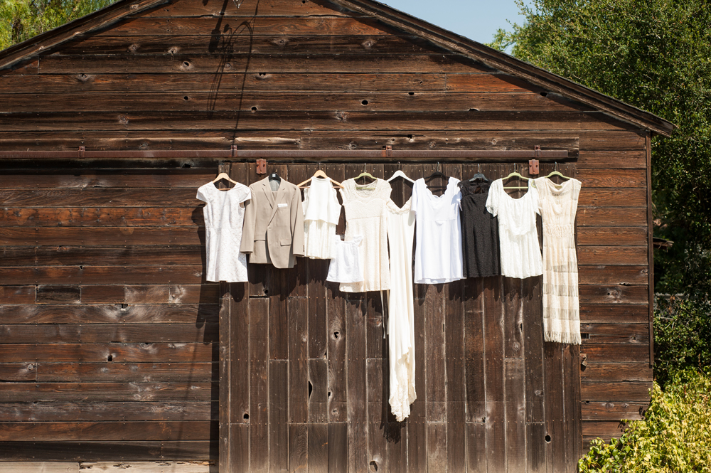 Wedding dresses hanging on wooden rustic barn