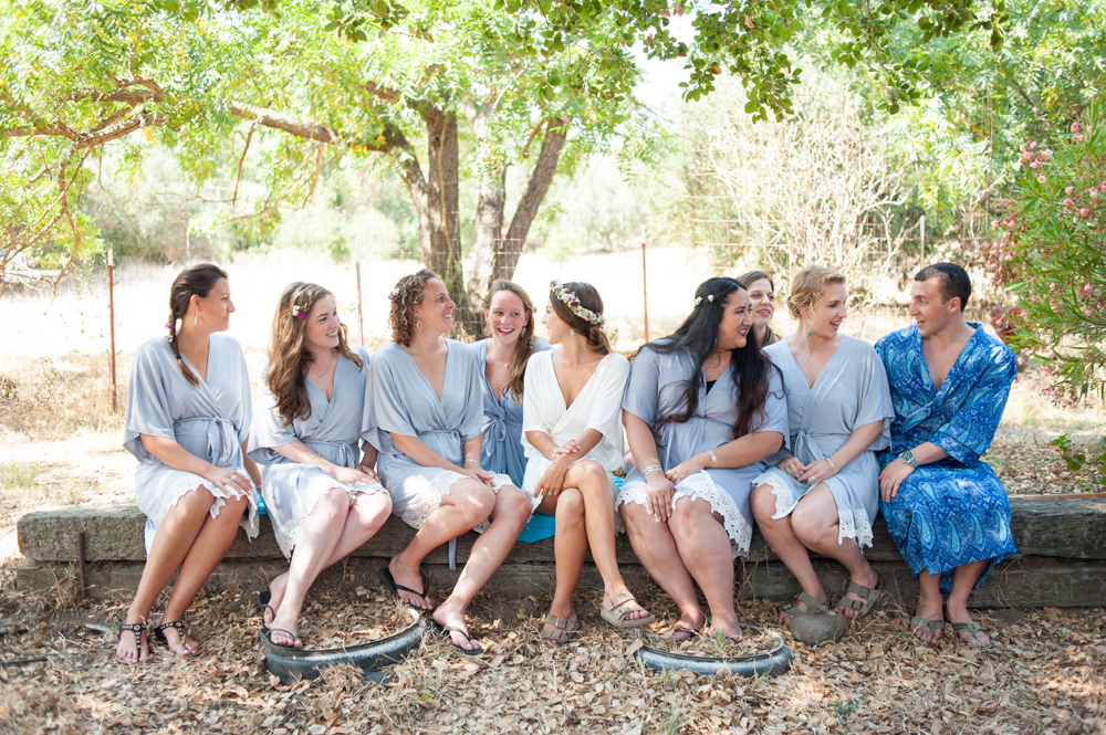 Candid photo of bride and bridesmaids in bathrobes
