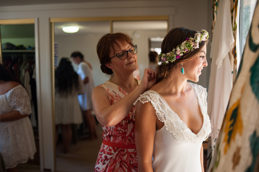 Mother of bride helping Bride with her jewelry