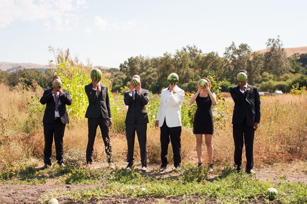 Groom and Groomsmen holding up watermelons
