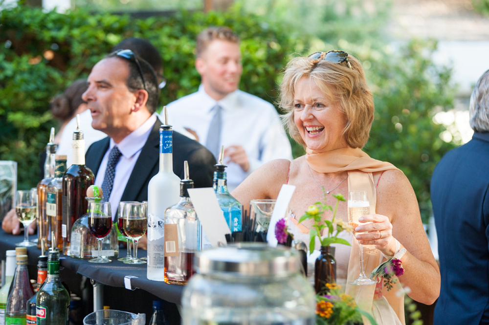 Candid of woman ordering drink at wedding