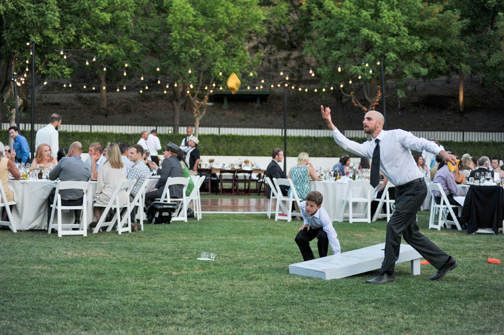 Wedding guest playing cornhole