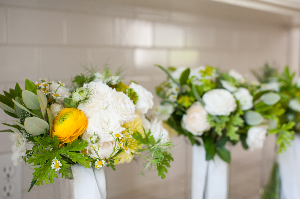 Yellow and white wedding bouquets on white counter