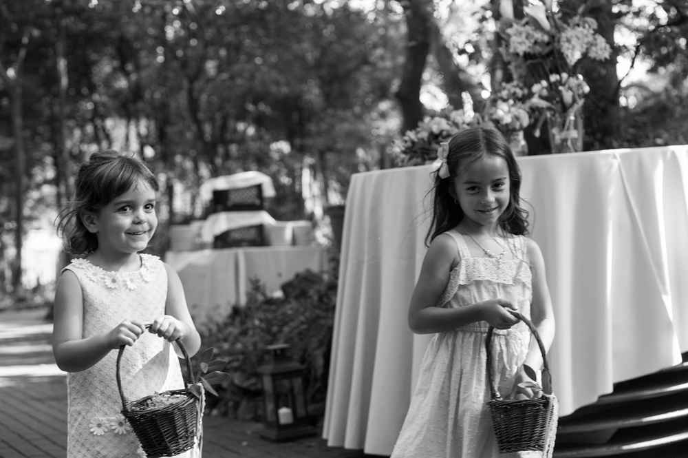 Flower girls walking down aisle at Scout Rock wedding