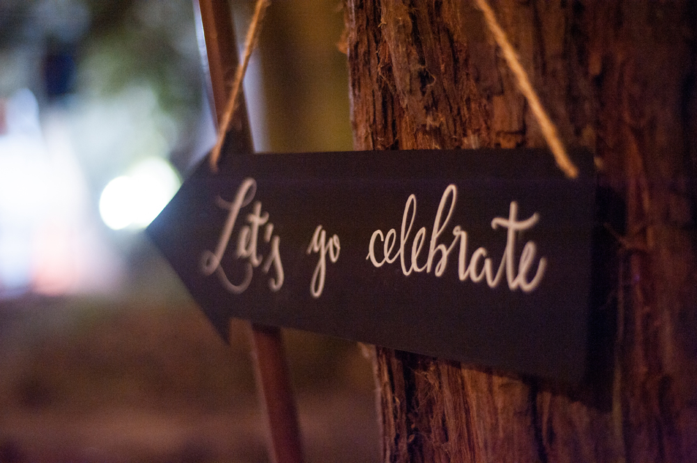 Hand painted sign that says lets go celebrate
