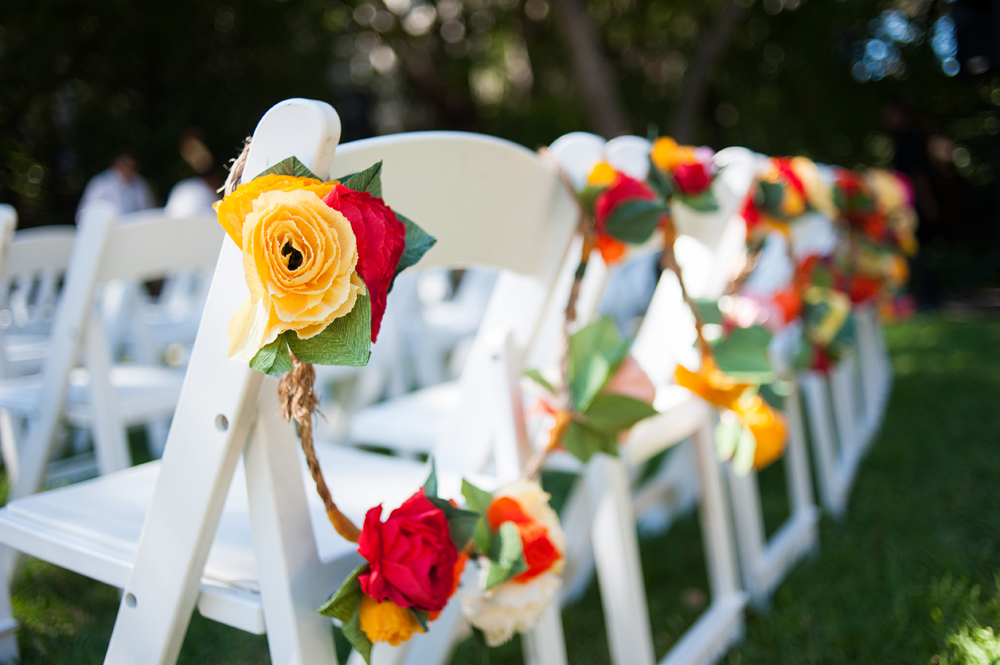Wedding ceremony decorated with a string of paper flowers