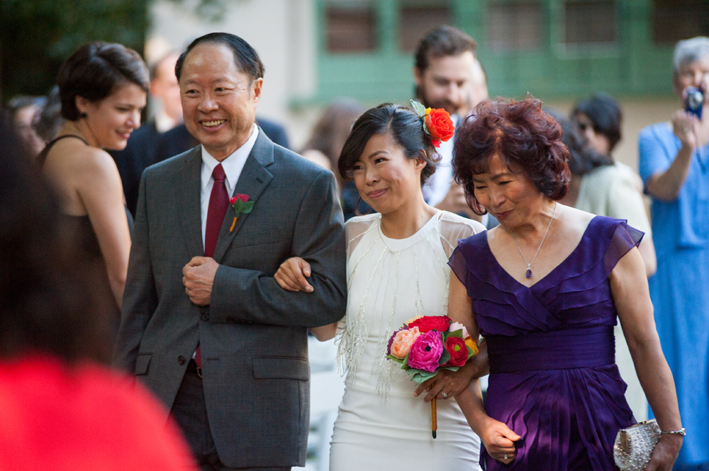 Bride and her parents walking down the aisle at the Faculty Club at UC Berkeley