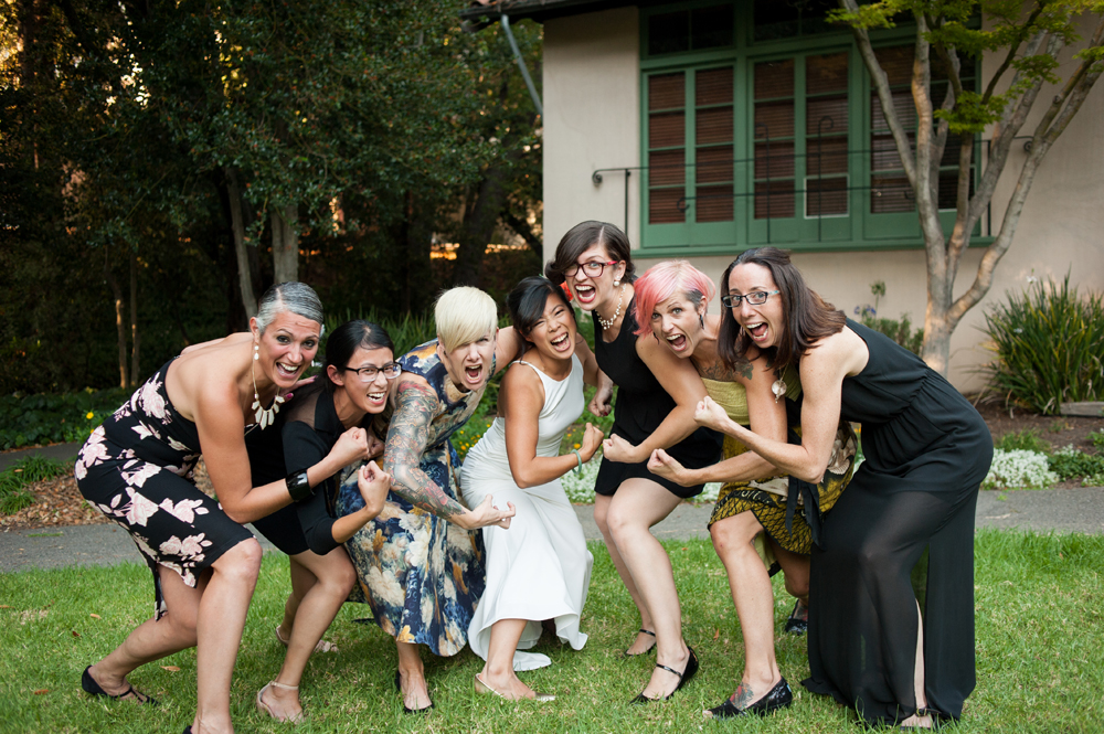 Portrait of bride and her friends flexing muscles at UC Berkeley