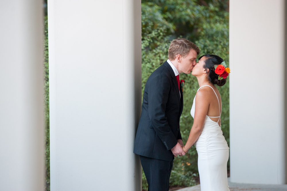 Wedding photo of bride and groom kissing on UC Berkeley campus