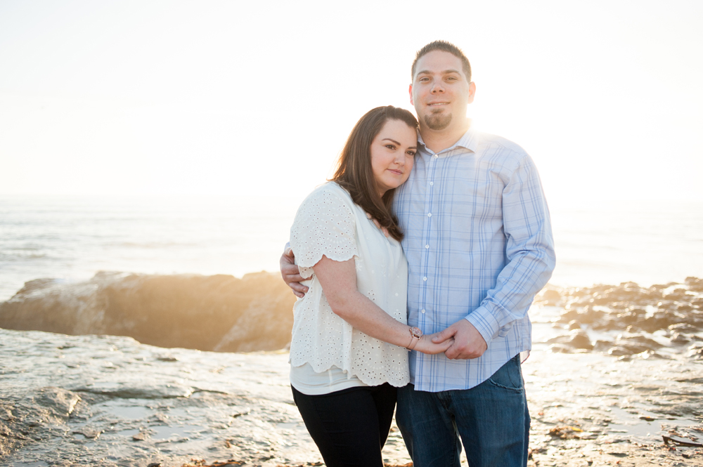 Backlit portrait of couple at the ocean near Santa Cruz, CA