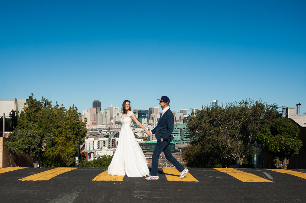 Just married couple walking across street in San Francisco