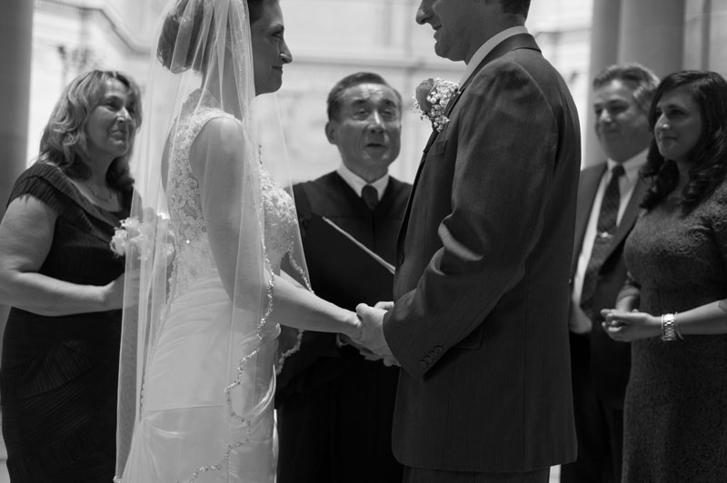 Couple during wedding ceremony at San Francisco City Hall