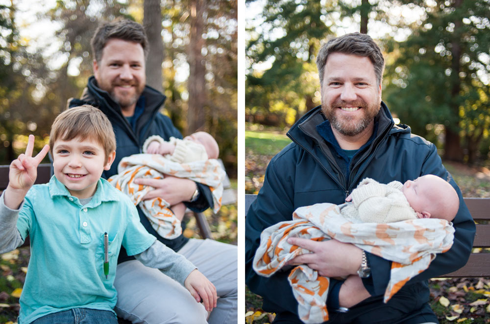 Uncle holding baby during family portraits in Berkeley