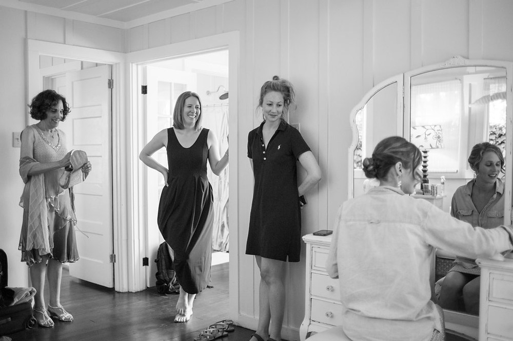 Bride with friends getting ready in a cabin at Dawn Ranch