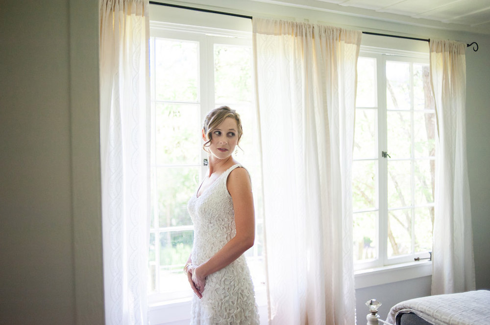 Natural light portrait of bride in wedding dress at Dawn Ranch