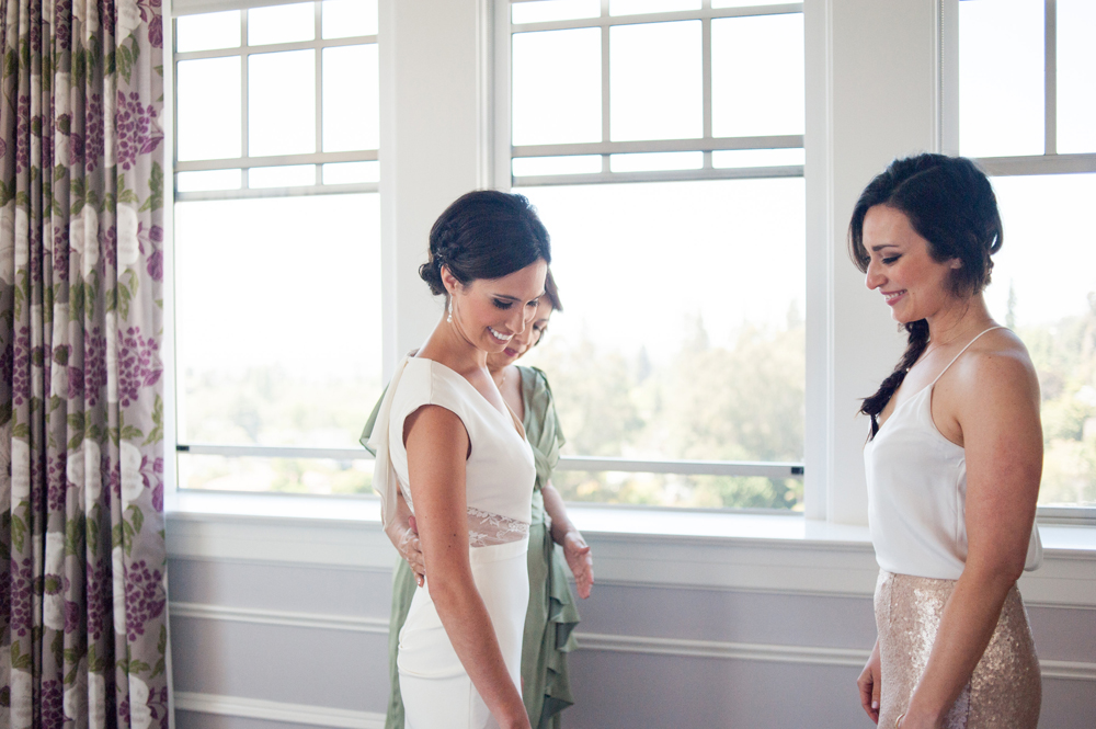 Candid portrait of bride with mother and sister at the Claremont Hotel