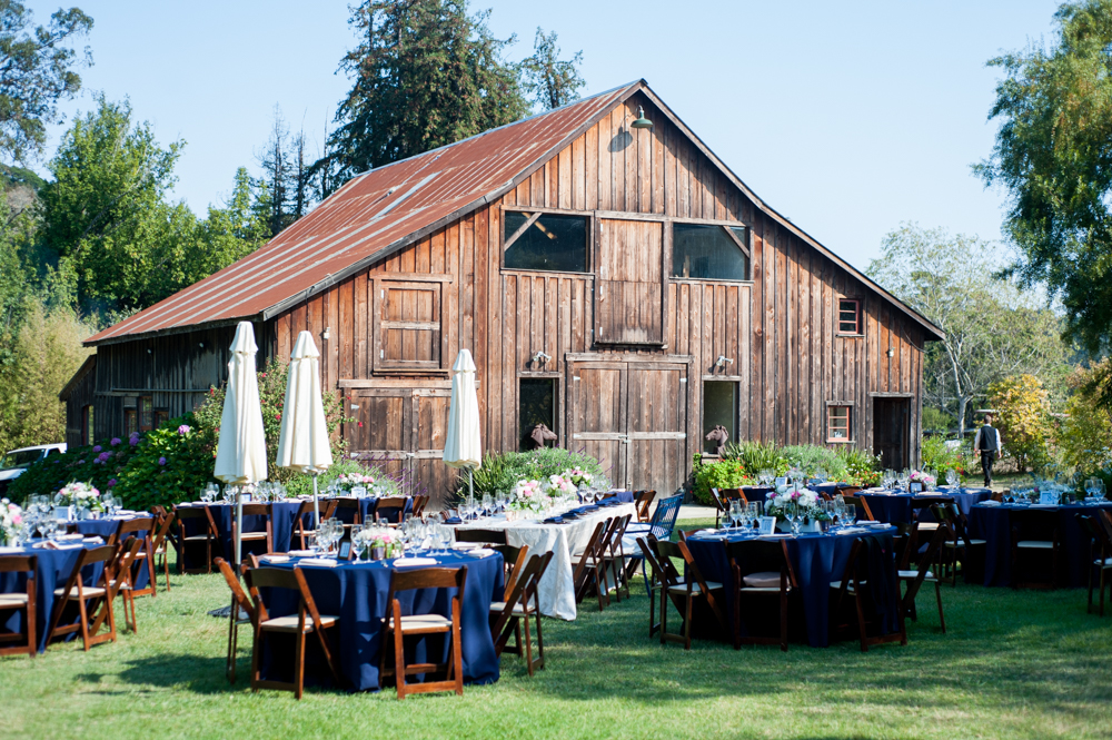Wedding reception in front of rustic bar at Rancho Soquel