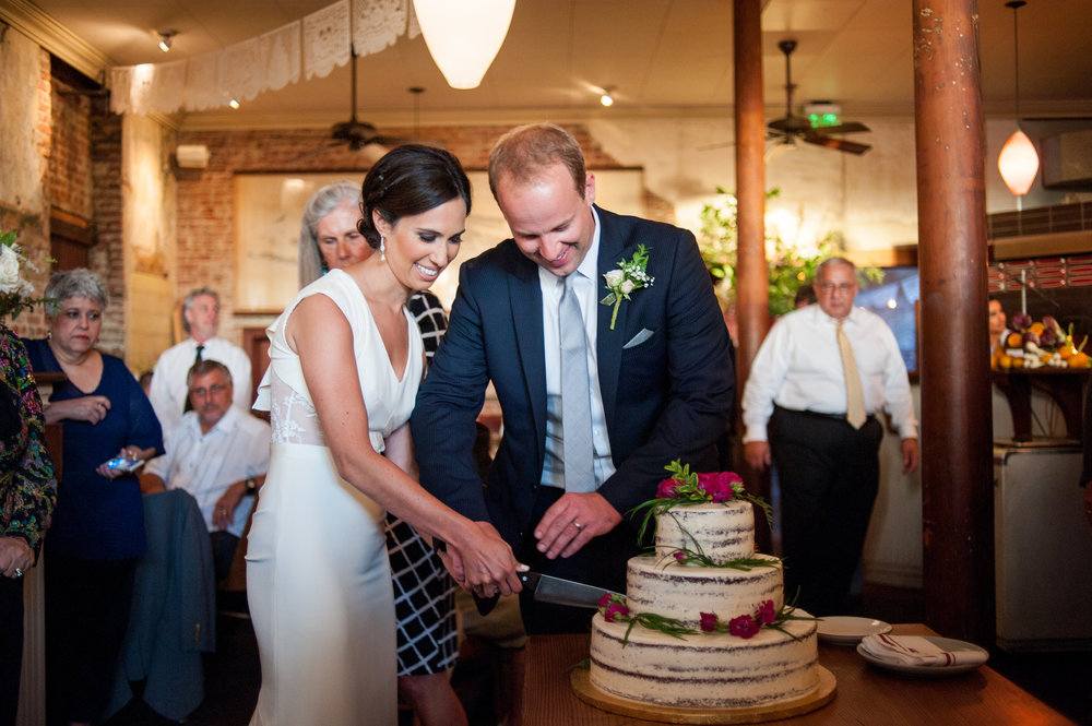 Bride and Groom cutting cake in Portland restaurant