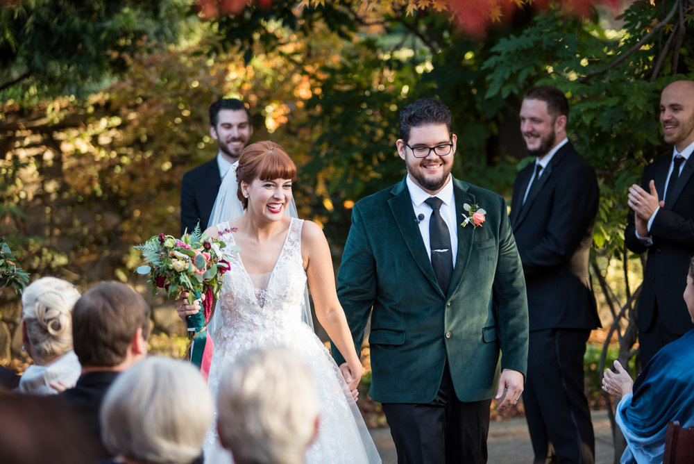 Bride and Groom walk down aisle together