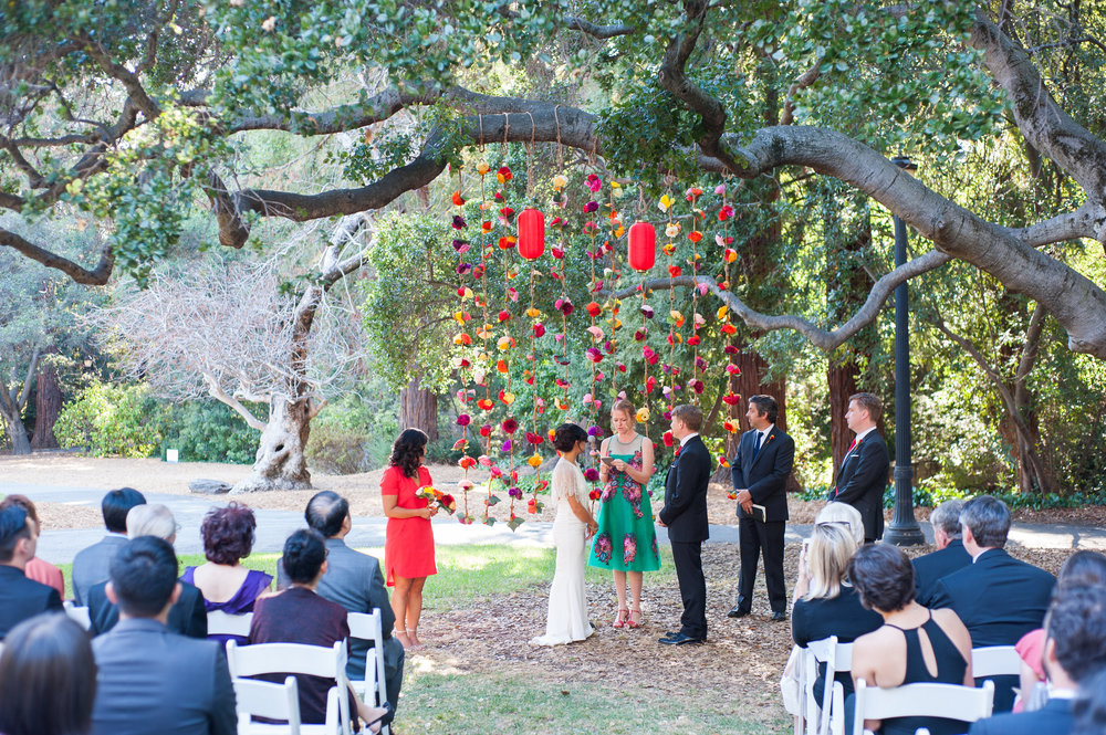 Ceremony with paper flowers and lanterns in background