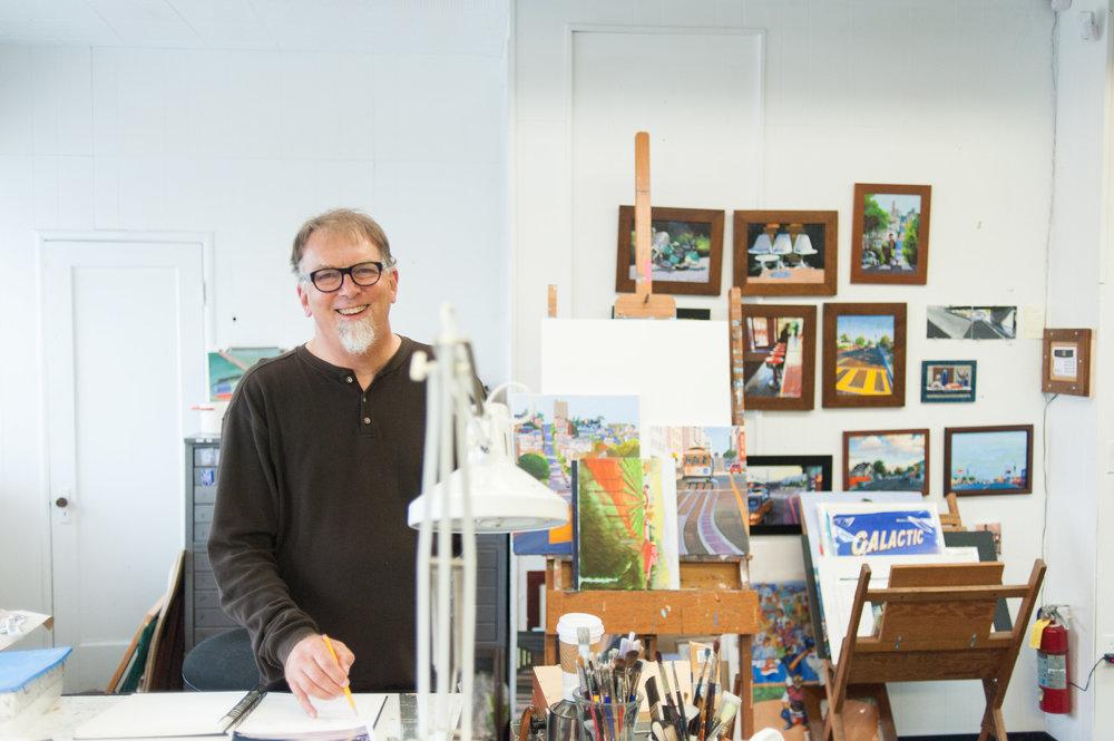 Environmental portrait of artist in Portland home studio