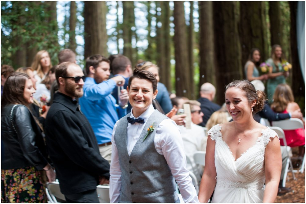 Married couple walking down the aisle in the redwoods