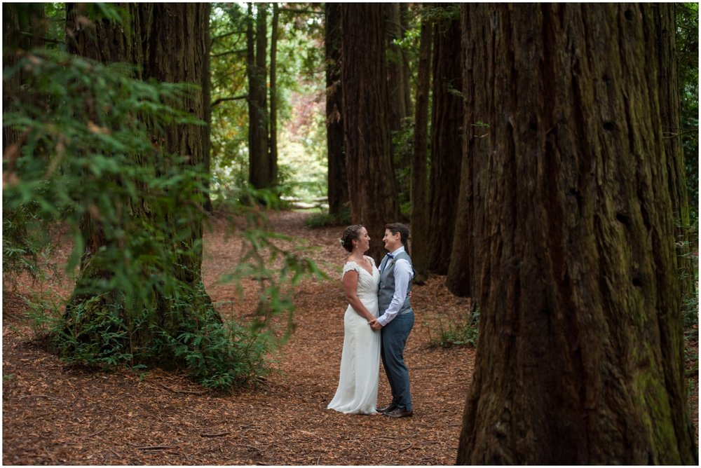 Married couple surrounded by redwoods at Roberts Recreation Area in the Oakland Hills