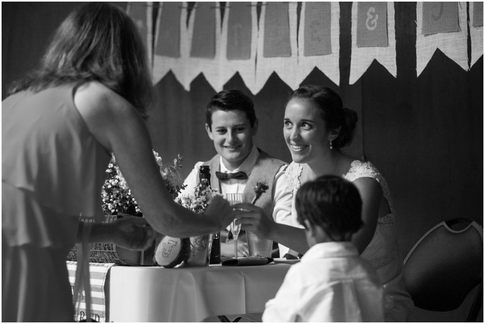 Wedding guest talking to couple during reception at Sequoia Lodge