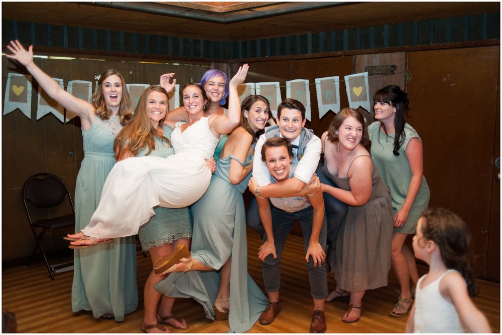 Wedding party holding bride at Sequoia Lodge